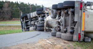 truck accident lies on road